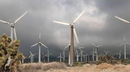 Pan across windmill generating electrical power on a Stock Footage