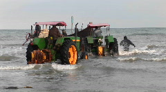Several tractors roll into the water off the coast of Iran. Stock Footage