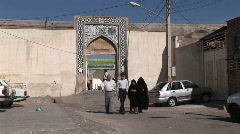 Two women wearing chadors and two men pass on a street in Iran. Stock Footage