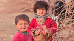 Two Iranian children in a rural location. Stock Footage