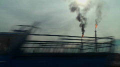 Burning extraction wells in an oil or natural gas field in Iran. Stock Footage