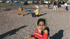 Children play on a see-saw in Iran. Stock Footage