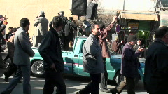 Stock Video Footage of Protesters march down a busy street in Iran.