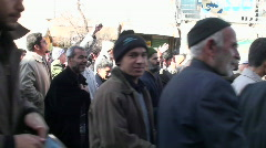 Protesters march down a busy street in Iran. Stock Footage