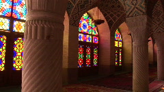 Sun shines through stained glass windows inside the Nasir Stock Footage