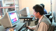 Stock Video Footage of A man works on a computer in an office in Iran.