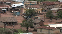 The people of a small African village go about their afternoon activities. Stock Footage