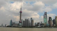 Stock Video Footage of Boats on the Yangtze River passing the Pudong district in Shanghai.