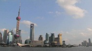 Stock Video Footage of An establishing shot of Shanghai, China with the Huangpu River in foreground.