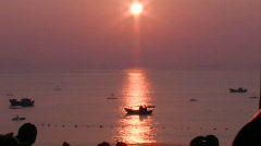 A small boat at sea at sunset in an Asian marina. Stock Footage
