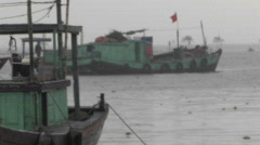 A ship along with other two ships are standing aside in the sea shore in Stock Footage