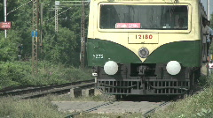 A train passes along an Indian railway track. Stock Footage
