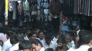 People are walking through a crowded market in India. Stock Footage