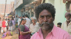 An Indian man stands outside in a busy area. Stock Footage