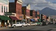 People walk along a street in a quaint Western town. Stock Footage