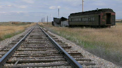 An old abandoned Pullman railway car sits on a siding along Stock Footage