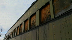 An old abandoned Pullman railroad car is boarded up. Stock Footage