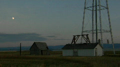 A water tower stands in a small prairie town. Stock Footage