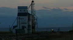 A train approaches a grain elevator. Stock Footage