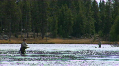 Men fly fish in a broad shallow river. Stock Footage