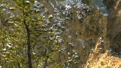 A waterfall flows down a mountainside in Yellowstone National Park. Stock Footage