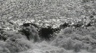 Water tumbles over rocks in a river. Stock Footage