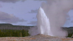 Old Faithful erupts at Yellowstone National Park. Stock Footage