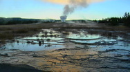 A geyser sends steam into the sky at Yellowstone National Park. Stock Footage