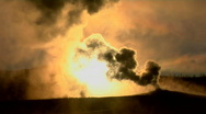Dark clouds rise from a volcanic eruption in a geothermal Stock Footage