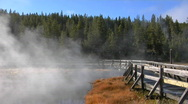 Steam rises from a geothermal pool in Yellowstone National Park. Stock Footage