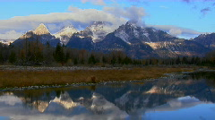 The Grand Teton mountains are perfectly reflected in a Stock Footage