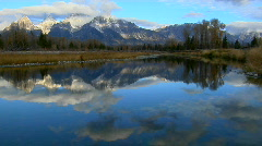 The Grand Teton mountains are reflected in a mountain lake. Stock Footage