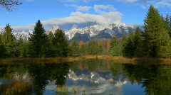The Grand Teton mountains are reflected in a lake. Stock Footage