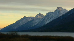 A lake sits below the Grand Teton mountain range. Stock Footage