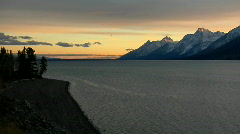 The Grand Teton Mountains stand at the end of a majestic lake. Stock Footage