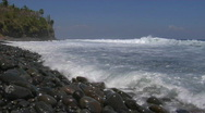 Waves roll onto a rocky beach. Stock Footage