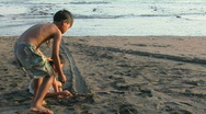 Children roll bottle caps down a narrow track. Stock Footage
