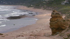 A person walks along a lonely but scenic beach. Stock Footage