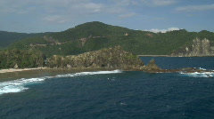 Aerial (truly spectacular!) along Rock Formation in front of beach bay Stock Footage