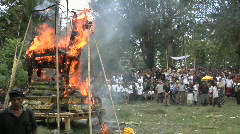 A funeral pyre burns at a cremation ceremony in Indonesia. - stock footage