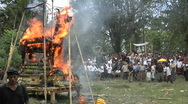 Stock Video Footage of A funeral pyre burns at a cremation ceremony in Indonesia.