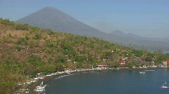 A white boat pulls into a harbor in Indonesia. Stock Footage