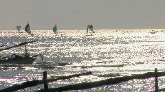Small boats move across the shimmering ocean. Stock Footage