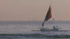 People row a fishing boat to into shore off the coast of Stock Footage