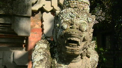A Balinese God stone carving guards a temple. Stock Footage