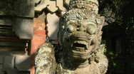 Stock Video Footage of A Balinese God stone carving guards a temple.