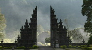 Stock Video Footage of The fog drifts by a traditional Balinese temple gate in