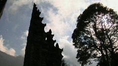 The clouds pass over a Balinese temple gates in Bali, Indonesia. Stock Footage