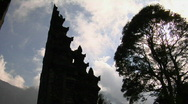 Stock Video Footage of The clouds pass over a Balinese temple gates in Bali, Indonesia.