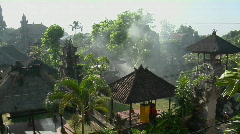 Smoke rises from the middle of the Balinese village in Indonesia. Stock Footage